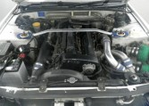 The twin-turbo 2.6-liter engine of a 1993 Nissan Skyline GT-R (R32) exported by Japan Car Direct