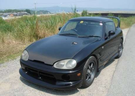 Black turbocharged JDM Suzuki Cappuccino pocket rocket