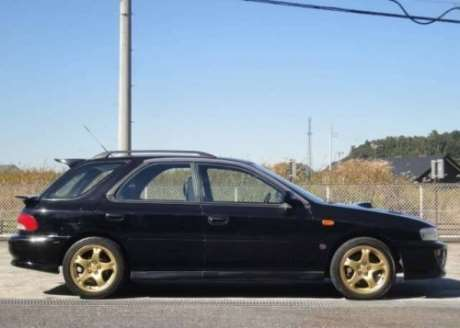 Black JDM high-performance 1998 Subaru Impreza WRX STi Sports Wagon Version V with turbocharged engine and all wheel drive