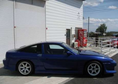 Blue JDM 1990 Nissan 180SX with 175 hp engine and 5-speed manual transmission in nearly stock condition