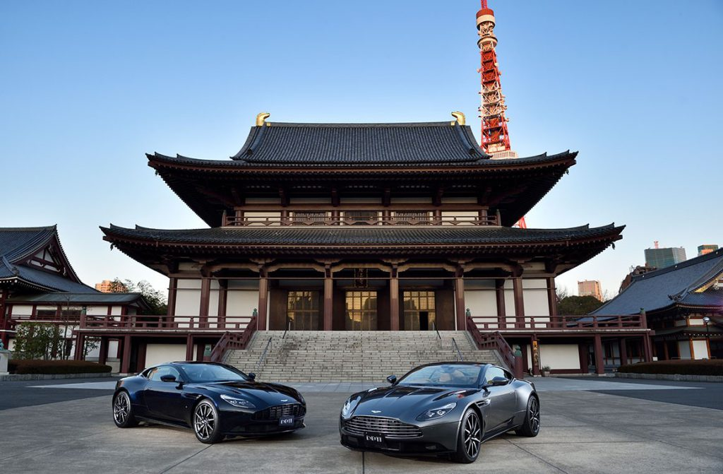 Aston Martin is Huge in Japan: Two Aston Martins with Zojo-ji Temple and Tokyo Tower in the background