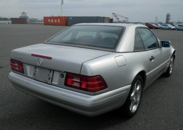 1996 Mercedes Benz SL500,rear right view,silver exterior,red tail lights,Japanese used car auction