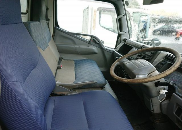 2006 Mitsubishi Canter Dump Truck. Cab interior from driver's side