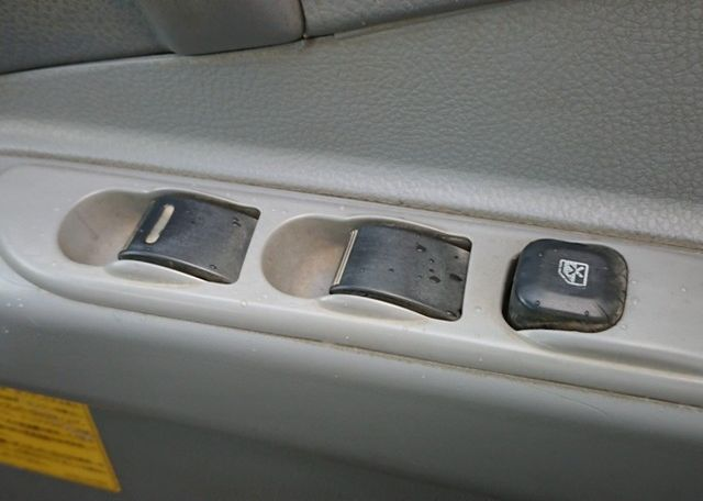 2006 Mitsubishi Canter Dump Truck. Power window controls. Simple and clean