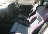 Used Lancer Evo for import from Japan via Japan Car Direct. Interior cockpit passenger side