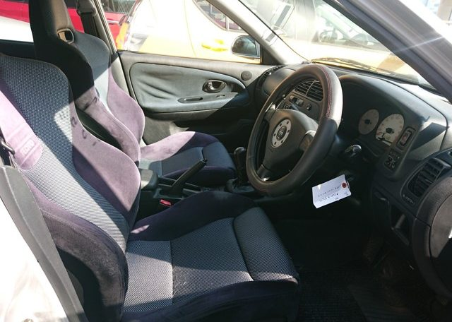 Used Lancer Evo for import from Japan via Japan Car Direct. View from driver door