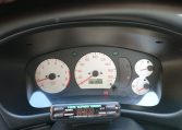 Used Lancer Evo for import from Japan via Japan Car Direct. Instrument cluster with turbo timer