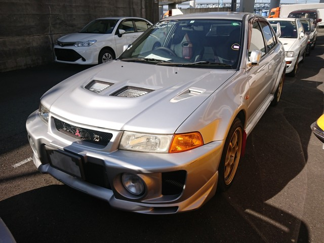S and E Lancer Evo to NZ IN TEXT PHOTO 1. Mitsubishi Lancer GSR Evolution V from Japan. Now can be imported New Zealand